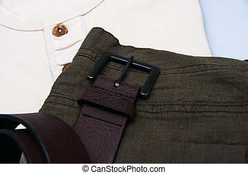 Mens dress pants trousers and belt isolated against whitebackground