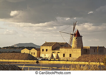 Windmill at sunset in the saltern near Marsala, Sicily