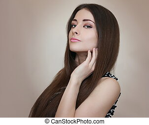 Sexy female model with long hair looking. Portrait