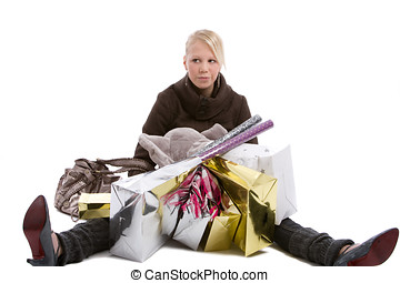 Tired shopper - Young teenage girl sitting on the floor with...