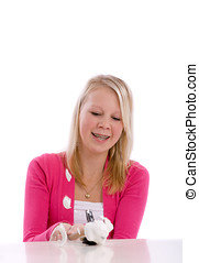 Smashing the piggy-bank - Cute teenager smashing her...