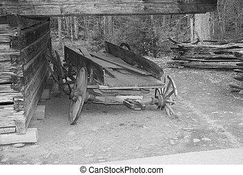 old wagon - an oldtime wagon and barn