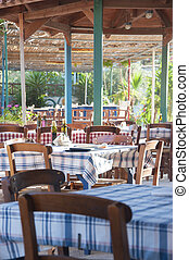 Greek tavern - Traditional tables and chairs in greek tavern