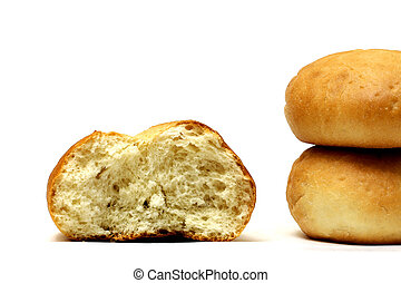 Half-eaten bun and two buns isolated on a white background.