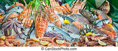 Seafood arrangement - Fresh seafood arrangement displayed in...
