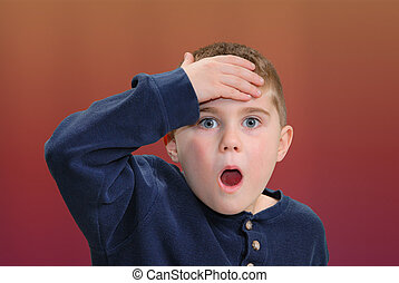 You\'re Kidding! - Boy with hand to head with surprised...
