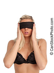 attractive woman blindfolded on white