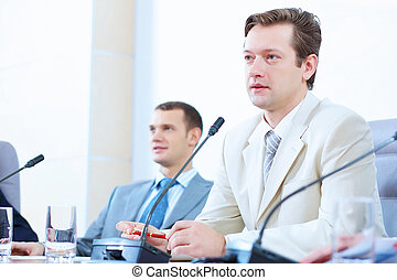 Two businesspeople at meeting - Image of two businesspeople...