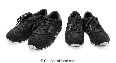Pair of black running shoes on a white background