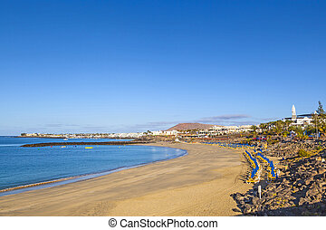 beach of Playa Blanca without people in early morning -...