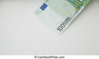 falling 100 euro money notes