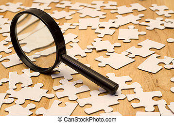 Piece Of The Puzzle - Magnifying glass looking for a piece...