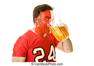 Beer Guzzling Sports Fan - Sports fan guzzling a pitcher of...