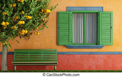 Old house with green windows bench - Colorful old house with...