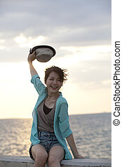girl happiness emotion at sea beach location - face of girl...