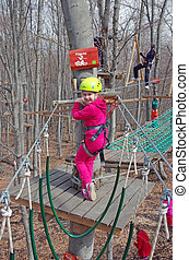 Little climber - MAGURA, ROMANIA - APRIL 05: Little girl...