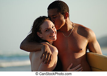 Young couple on the beach - A young attractive couple...