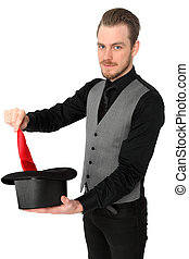 Magician performing with a red handkerchief and top hat....