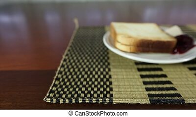 Coffee and Toast - A cup of coffee and toast with jam and...