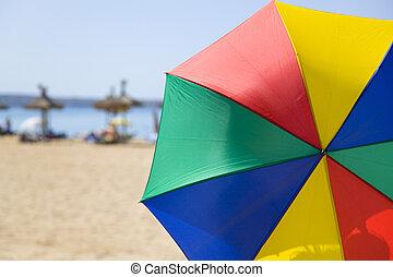 Sunny umbrella - Multicolored umbrella at the beach