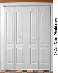 closet door - closeup on white double closet door