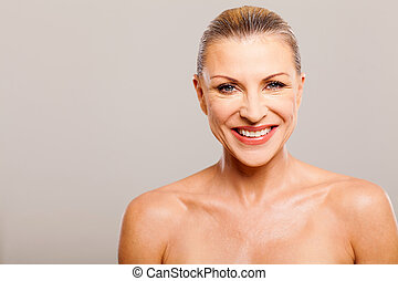 senior woman wearing make up - beautiful senior woman...