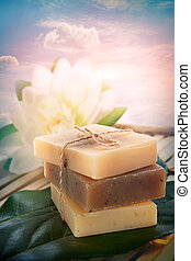 Spa natural soaps - Spa setting with soaps and lotus flower.