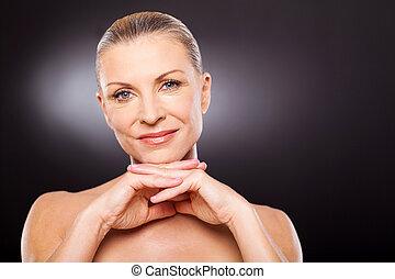 modern senior woman wearing makeup