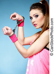 teen crime - teenager girl in handcuffs studio shot blue...