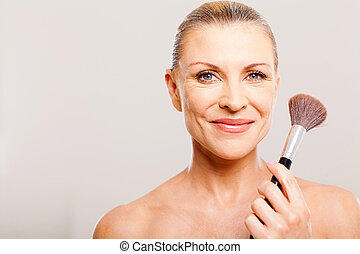senior woman after applying make up - beautiful senior woman...