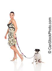 pretty woman walking with dog isolated on white