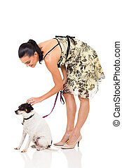 modern woman with pet dog isolated in white background