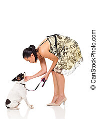 caring pet owner playing with her dog