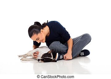 casual woman playing with dog - casual woman sitting on...
