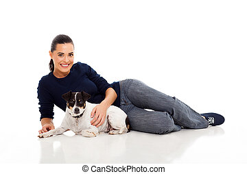 young woman laying with her dog