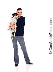 pretty woman holding her pet dog