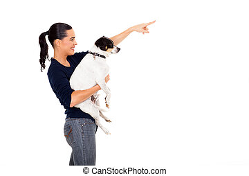 happy woman holding dog and pointing - happy young woman...