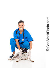veterinarian assistant with pet dog