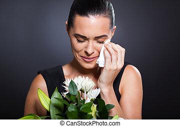 crying woman at funeral - sad crying woman at funeral