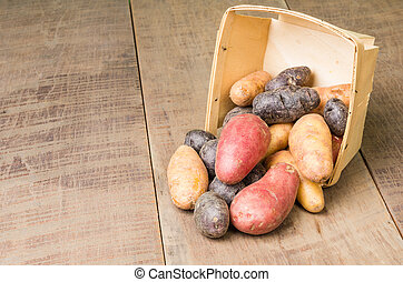 Colorful potatoes in basket - Colorful potatoes in a wooden...