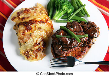Beef tournedos meal from above - A meal of beef tournedos on...
