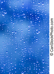 rain drop blues - rain droplets on a window creating...