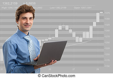 Stock broker at work with his laptop