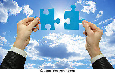 puzzle in hands - puzzle in hand isolated on sky background...