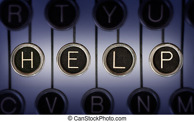 Old Help - Close up of old typewriter keyboard with...
