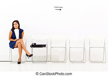 career woman waiting for job interview - young career woman...
