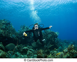 Diver smiling underwater on a Caribbean Reef