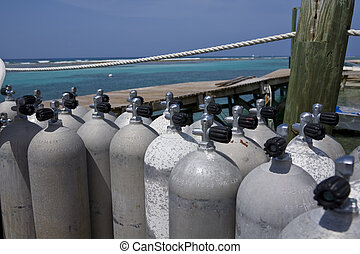 Scuba Tanks in the Caribbean - Scuba Tanks on a Dock with...