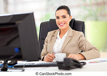 businesswoman in office - happy young businesswoman in...