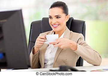 business woman having tea - caucasian business woman having...